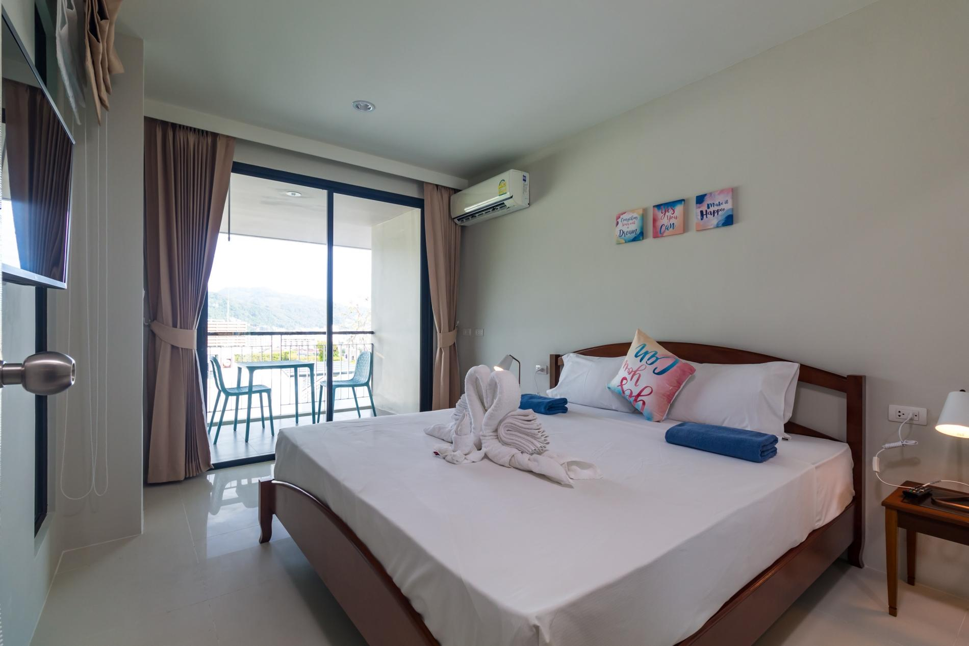 U606 - Convenient Patong apartment for 3 people with pool and gym. photo 19104152