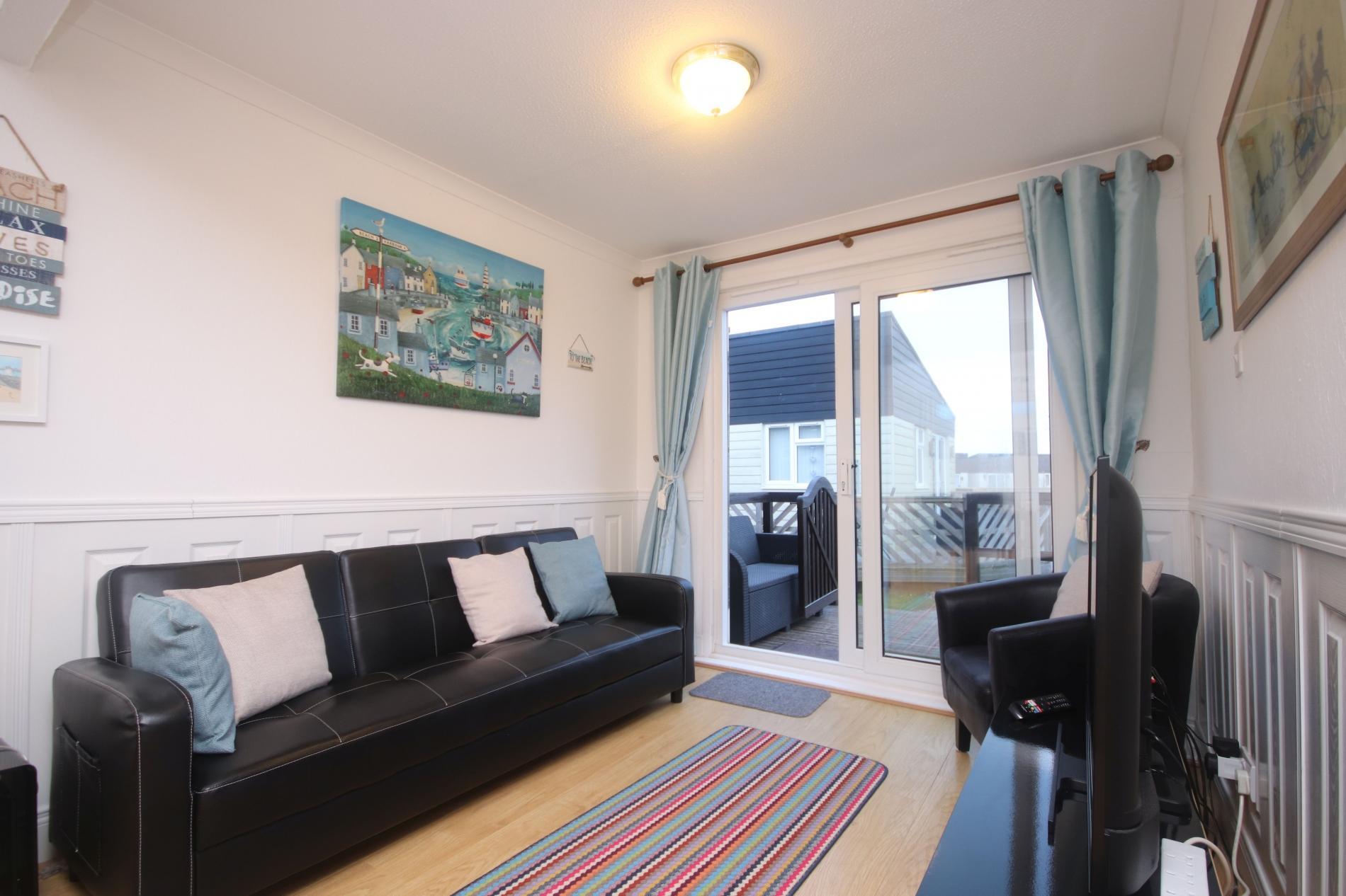 22E Medmerry Park 2 Bedroom Chalet Near Coast